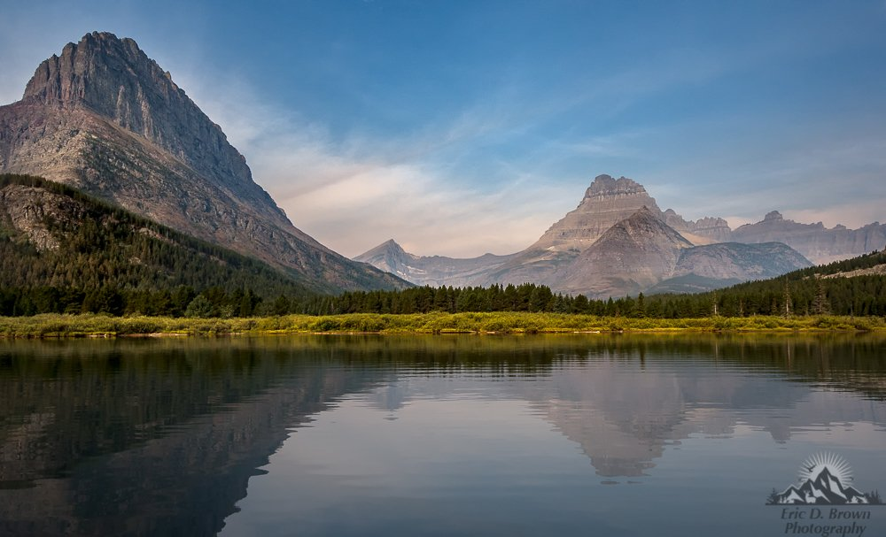 This is a landscape photo of Mount Grinnell from Swiftcurrent lake. There was quite a bit of haze around which made for some interesting lighting and colors.